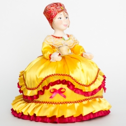 Doll-warmer on a teapot with a cup of tea yellow 30cm